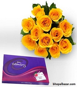 Yellow roses with cadbury celebration